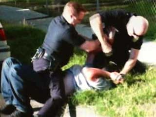 2_61_111006_police_beating2.jpg
